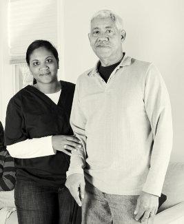 caregiver and senior man smiling