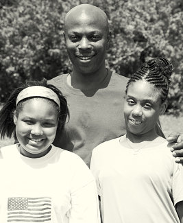 young girls with man smiling